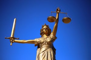 Lady justice legal thuggery